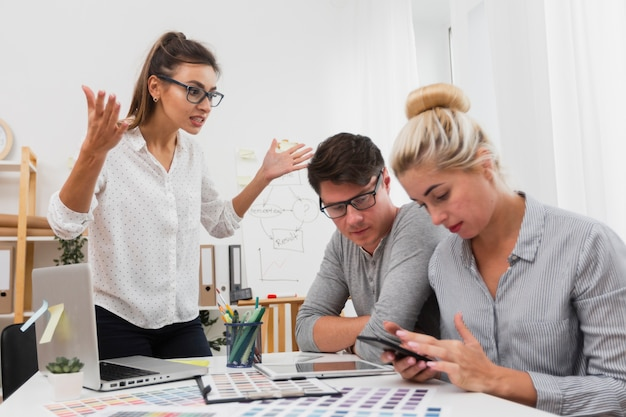 Upset woman looking at her business partners Free Photo
