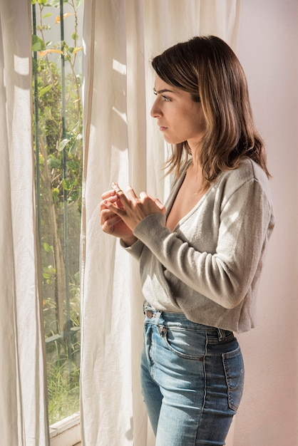 Upset woman pulling out wedding ring Free Photo