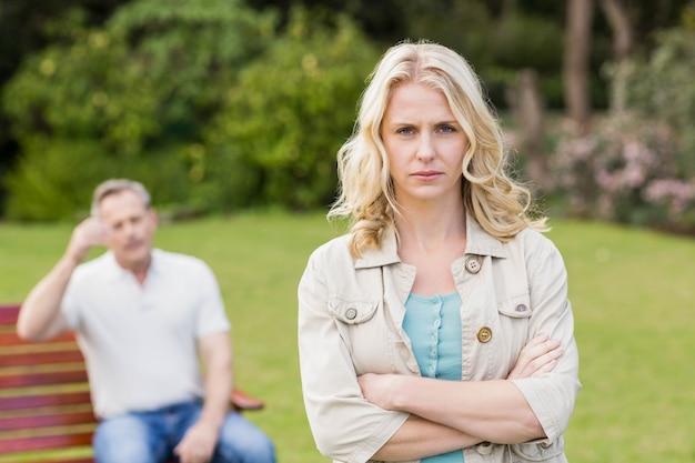 Upset woman sulking her boyfriend in the garden Premium Photo