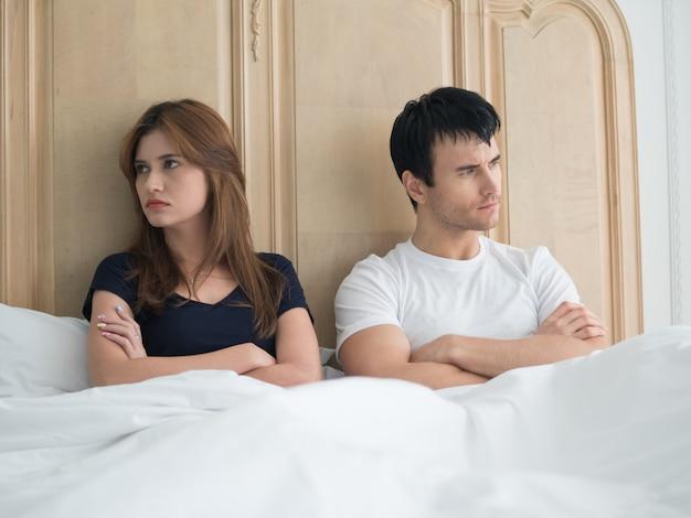 Upset young couple having problems in bedroom Premium Photo