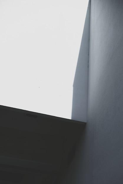 Urban building wall in shadow Free Photo