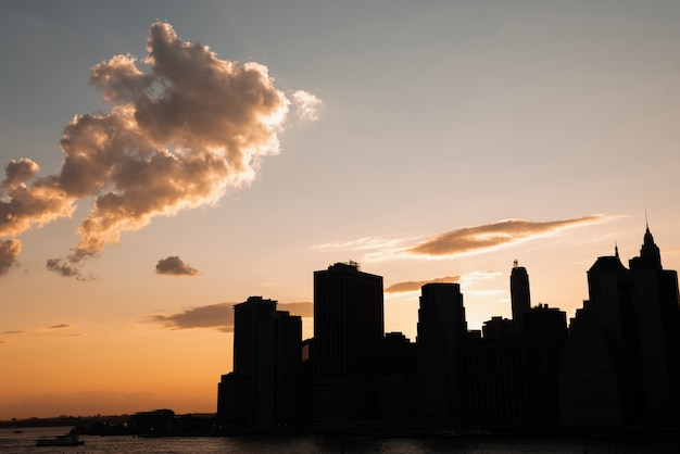 Urban skyline with skyscrapers at sunset Free Photo