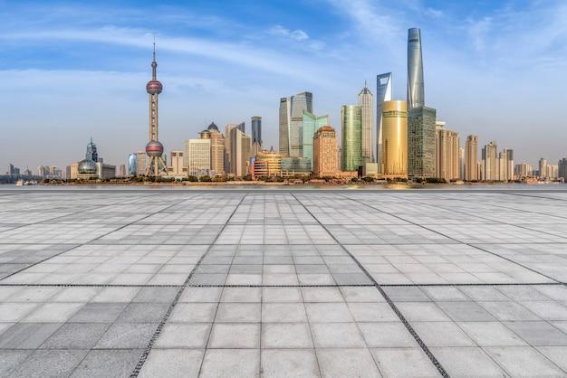 Urban skyscrapers with empty square floor tiles Premium Photo
