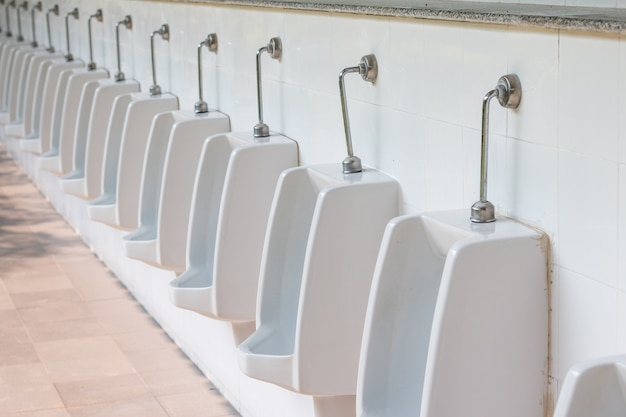 Urinal In Men Bathroom Premium Photo