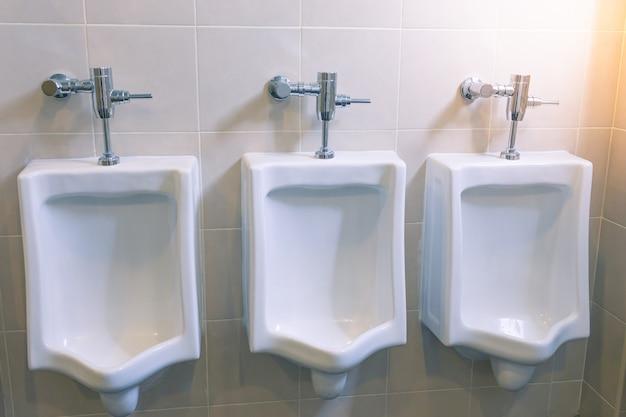 Urinals for men in the male bathroom Premium Photo