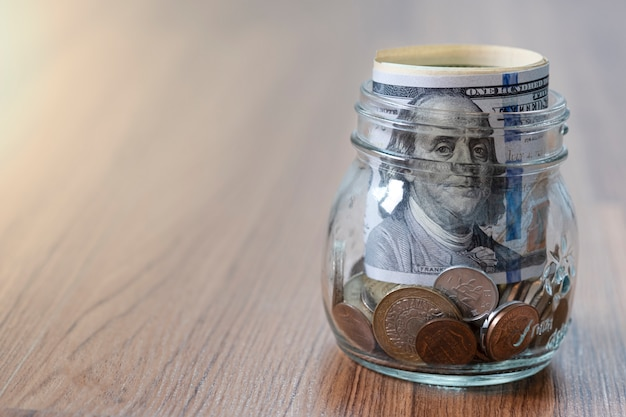 Us dollar banknote and coins into glass jar Premium Photo
