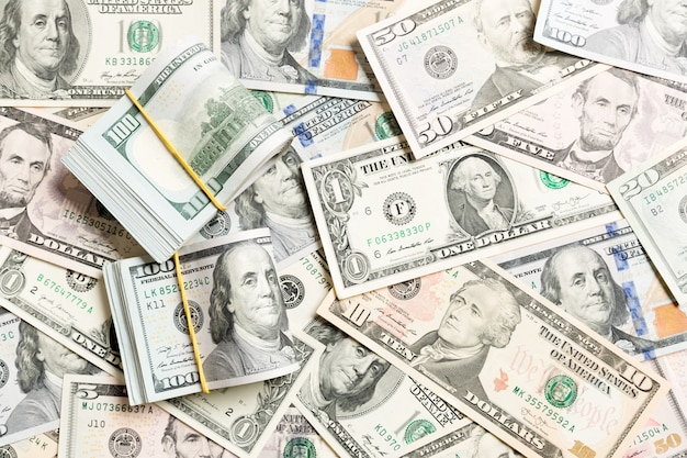 Us dollar bills bundles stack. one hundred dollar bills with stack of money in the middle. background Premium Photo
