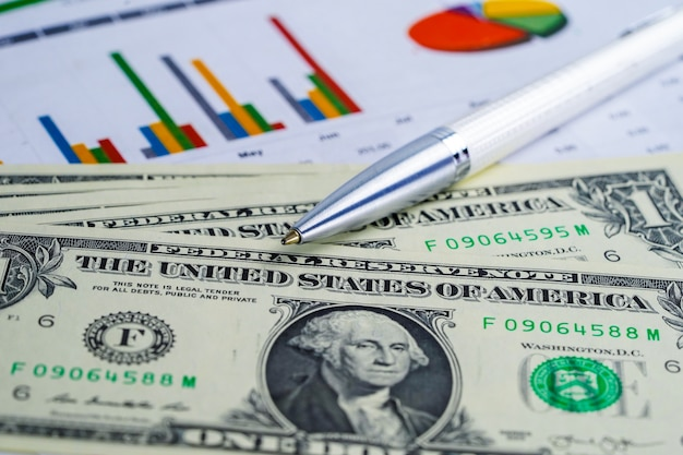 Us dollar and euro banknotes money on chart graph background paper. Premium Photo