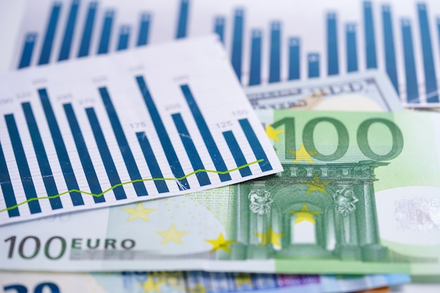 Us dollar and euro banknotes money on chart graph spreadsheet paper. Premium Photo