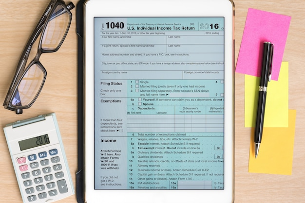 Us Tax Form 1040 In Tablet With Calculator And Pen Photo Free Download