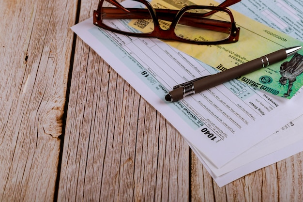 Usa 1040 tax form with glasses an financial office Premium Photo