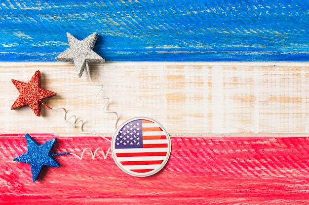Usa flag badges and stars on red and blue painted wooden textured backdrop Free Photo