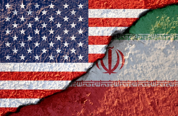 Usa flag and iran flag on cracked wall damage Premium Photo