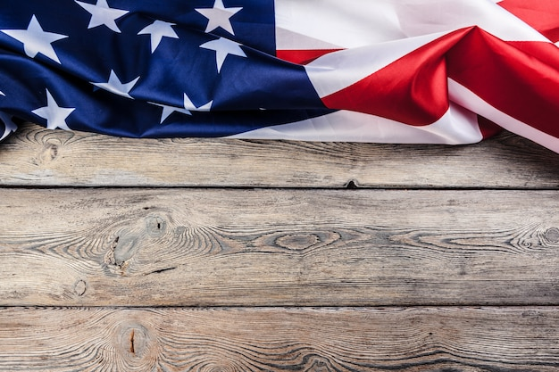 Usa flag on light wooden table background close up copy space Premium Photo