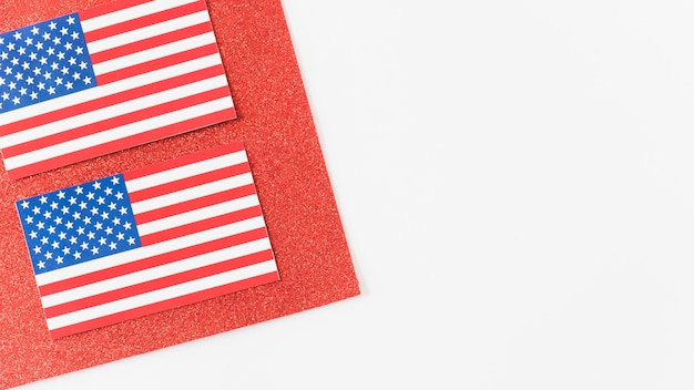 Usa flags on piece of red velvet Free Photo