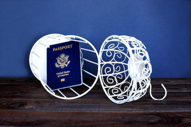 Usa passport in an open cage. there is access to imigration to the united states. Premium Photo