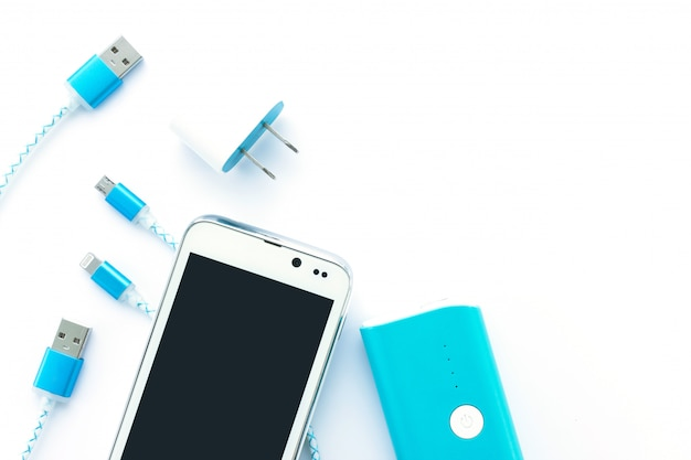 Usb cables and battery bank for smartphone and tablet in top view Premium Photo