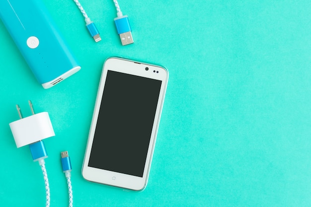Usb charging cables for smartphone and tablet in top view Premium Photo