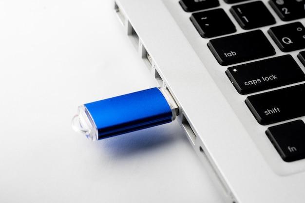 Usb flash drive on computer laptop keyboard Premium Photo