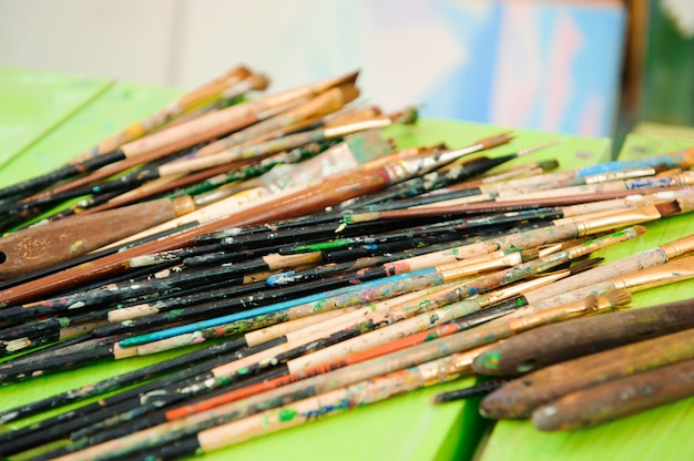 Used paint palette, watercolors, brush - art lesson Premium Photo