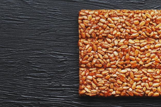 Useful snacks. fitness diet food. boletchik from kozinaki sunflower seeds, energy bars. Premium Photo