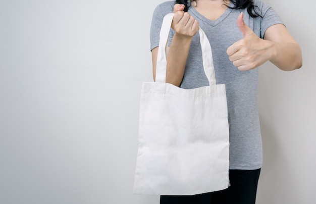 Using cloth bags instead of plastic for a good environment Premium Photo