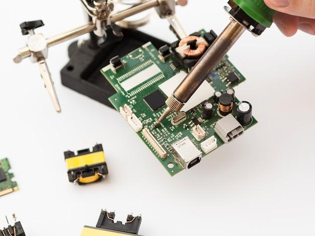 Using soldering iron to repair a circuit Premium Photo