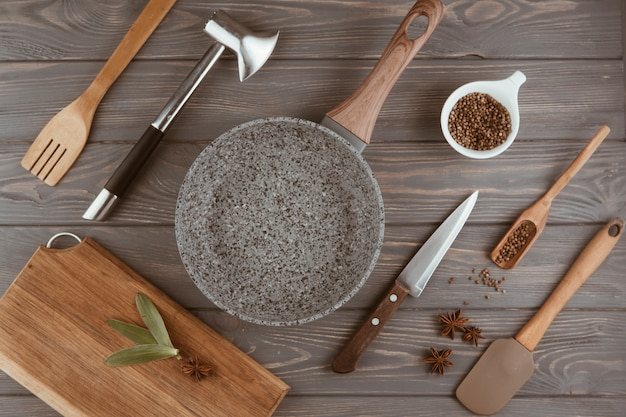Utensils kitchen on a wooden table Free Photo