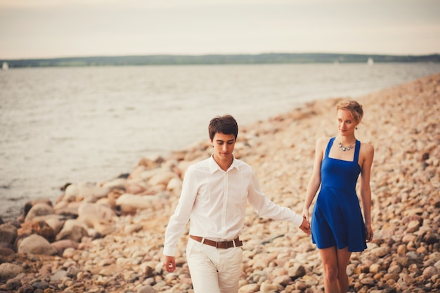 Vacation couple walking on beach together Premium Photo