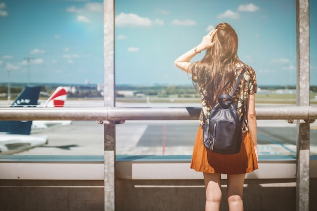 Vacation is beginning. young female passenger at the airport. Free Photo