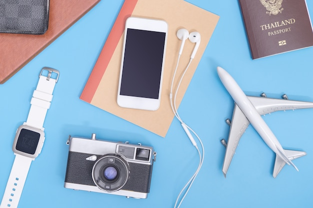 Vacation travel objects on soft blue background for travel concept Premium Photo