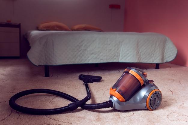 Vacuum cleaner on a bedroom background Premium Photo