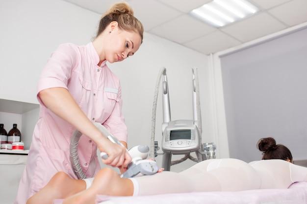 Vacuum massage device. anti cellulite body correction treatment. Premium Photo