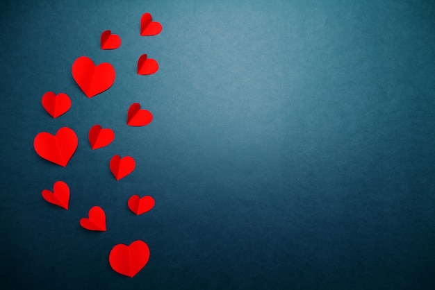 Valentine card with red heart on blue background, abstract, flat lay, top view Premium Photo