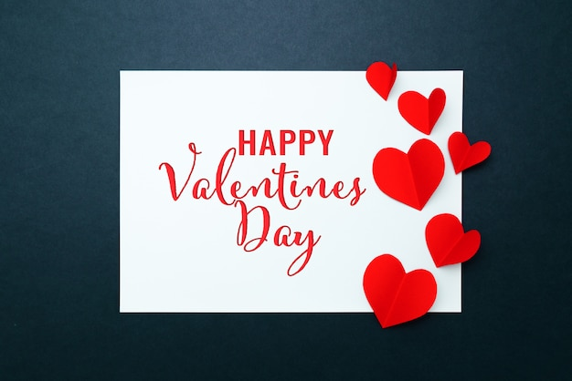 Valentine card with red heart on blue paper frame, flat lay, top view Premium Photo