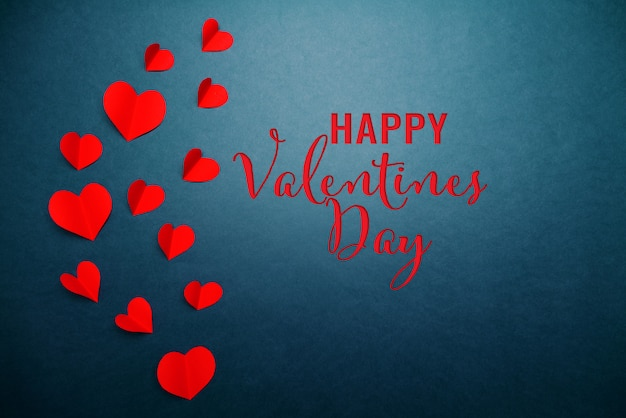 Valentine card with red heart on blue Premium Photo