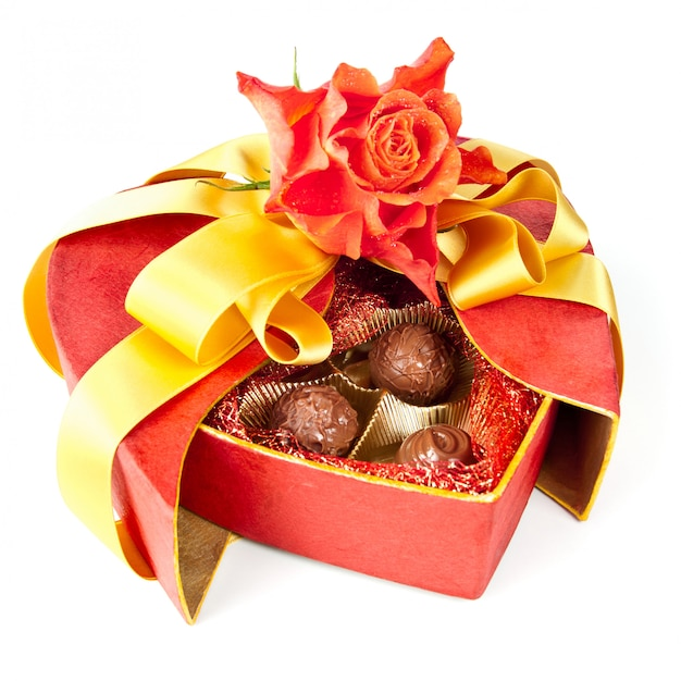 Valentine chocolates and a rose isolated on whit Premium Photo