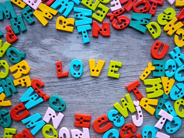 Valentine concept, colorful button alphabets with letters for love Premium Photo