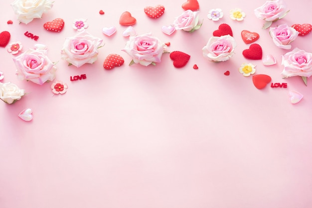 Valentine day gift box with red hearts and roses on pink backgro Premium Photo