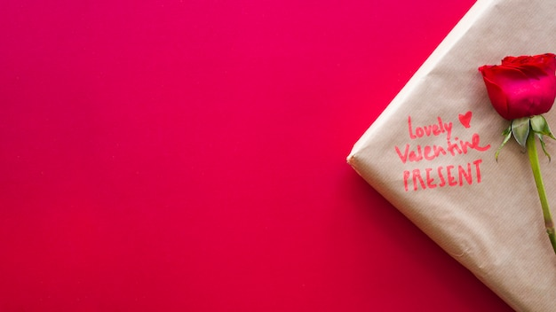 Valentine present with flower on table Free Photo
