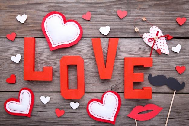Valentine's day background with decoration on grey background. Premium Photo