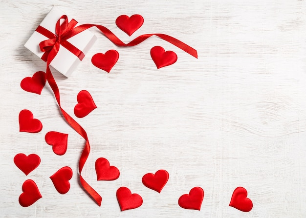 Valentine's day background. . with gift and red hearts, top view. san valentine and the concept of love. Premium Photo