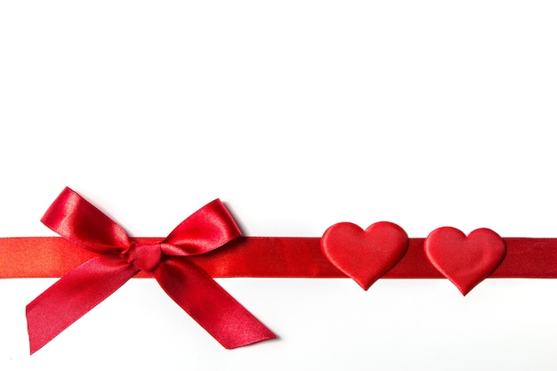 Valentine's day background with gift and red hearts, top view. san valentine and the concept of love. Premium Photo