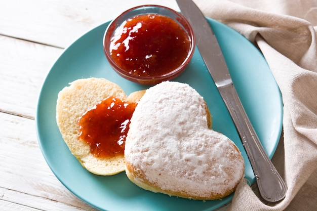 Valentine's day breakfast heart-shaped bun and berry jam close up Premium Photo
