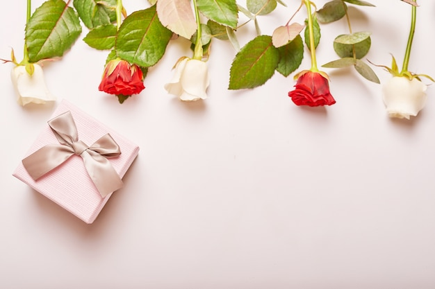 Valentine's day composition pink gift box with flowers. Premium Photo