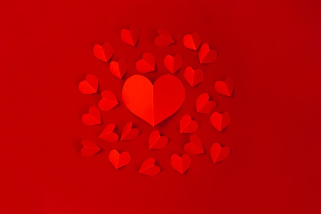 Valentine's day concept with red hearts on red background,  flat lay, copy space Premium Photo