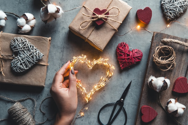 Valentine's day, gift box of kraft paper. packaging and preparation of gifts for the holiday. romance, date, love Premium Photo