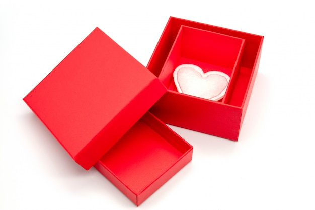 Valentine's day, gift box of kraft paper with a red ribbon and candles. rustic style Premium Photo