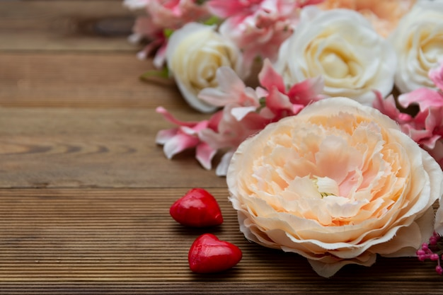 Valentine's day. gift flowers on wooden background with copy space. Premium Photo