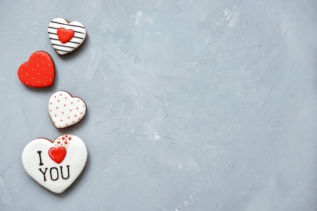 Valentine's day homemade cookies on ultimate gray background covered with icing with a beautiful pattern gingerbread. Premium Photo